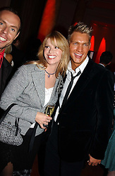 CINDY JACKSON and DANE BAILEY from the tV show Queer Eye For The Straight Guy at the Pink Ribbon Party - A night of Fashion and Music in aid of 3 cancer charities, Breast Cancer Haven, Cancer Resource Centre and Positive Action on Cancer, held at the Waldorf Hilton Hotel, Aldwych, London on 19th October 2004. <br /><br />MINIMUM REPRODUCTION FEE - SEE OUR WEB SITE<br /><br />NON EXCLUSIVE - WORLD RIGHTS-