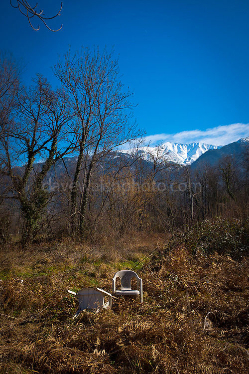 """Abandoned plastic chairs beneath a mountain, France This mage can be licensed via Millennium Images. Contact me for more details, or email mail@milim.com For prints, contact me, or click """"add to cart"""" to some standard print options."""