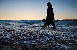 © Licensed to London News Pictures. 12/12/2017. Epsom, UK. A man and his dog brave the frosty weather on Epsom Downs after a night of freezing sub zero temperatures. Photo credit: Peter Macdiarmid/LNP