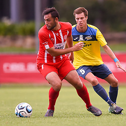 BRISBANE, AUSTRALIA - MARCH 4: Shelford Dais of Olympic turns away from Wade Hall of Thunder during the NPL Queensland Senior Mens Round 5 match between Olympic FC and SWQ Thunder at Goodwin Park on March 4, 2017 in Brisbane, Australia. (Photo by Patrick Kearney/Olympic FC)