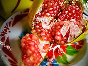 10 SEPTEMBER 2013 - BANGKOK, THAILAND: A pomegranate (Punica granatum) open for display at a pomegranate juice stand in Bangkok.       PHOTO BY JACK KURTZ