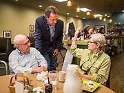 10 JULY 2019 - MARSHALLTOWN, IOWA: Governor STEVE BULLOCK (D-MT), center, greets voters during a campaign stop at a cafe in Marshalltown Wednesday. Gov. Bullock is in a crowded field of Democrats vying to be the party's Presidential nominee in 2020. Iowa traditionally hosts the the first election event of the presidential election cycle. The Iowa Caucuses will be on Feb. 3, 2020.    PHOTO BY JACK KURTZ