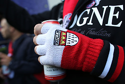 14 September 2017 -  UEFA Europa League (Group H) - Arsenal v FC Koln - The gloved hand of an FC Koln fan grips a can of lager - Photo: Mark Leech/Offside