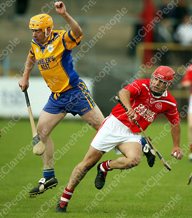 Inagh's Eugene Cullinan tries to stop Corofin's Michael Shannon from passing the ball during their game in Cusack Park on Sunday.<br /><br />Photograph by Yvonne Vaughan.
