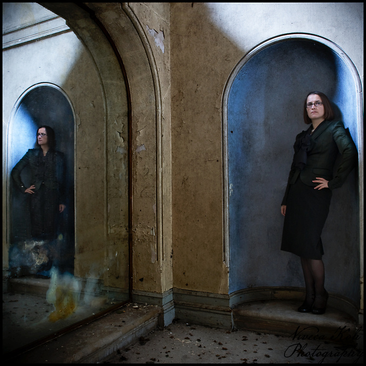 Miss V in an archway reflected in a mirror