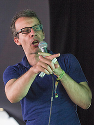 """© Licensed to London News Pictures . 21/07/2013 . Suffolk , UK . DAVID SCHNEIDER performs """" Is the Internet making us more stupider """" on stage in the Literary Arena . The Latitude music and culture festival in Henham Park , Southwold . Photo credit : Joel Goodman/LNP"""