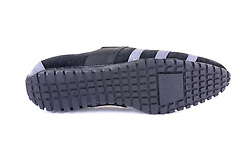 Studio Pack Shot of a Slip On Shoe showing the Detail of the Sole