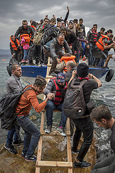 Oct. 11, 2015 - Lesbos Island, Greece - Refugees and Migrants aboard fishing boat drived by smugglers reach the Greek Island coast of Lesbos after crossing the Aegean sea from Turkey on October 11, 2015  (Credit Image: © Antonio Masiello/NurPhoto via ZUMA Press)