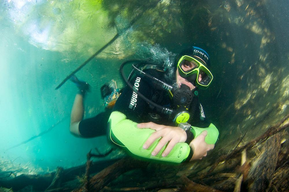 Scuba diver in a river in Mato Grosso do Sul, Brazil.