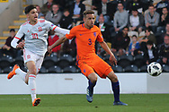 Nabil Touaizi Zoubdi of Spain (10) and Liam Van Gelderen of Netherlands (3) during the UEFA European Under 17 Championship 2018 match between Netherlands and Spain at the Pirelli Stadium, Burton upon Trent, England on 8 May 2018. Picture by Mick Haynes.