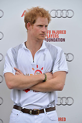 PRINCE HARRY at the Audi Polo Challenge at Coworth Park, Blacknest Road, Ascot, Berkshire on 31st May 2015.