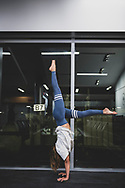 Atlanta, Georgia, USA - January 23, 2021: Alexandra Sheth, traveling from Miami to Detroit, does a handstand and stretches shortly before boarding her connecting flight to Detroit at Hartsfield-Jackson Atlanta International Airport.