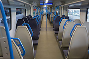As the UK government urged that all Britons should avoid non-essential travel abroad in order to combat the Coronavirus pandemic in Britain, a near-empty late-morning train carriage travels through the capital, on 17th March 2020, in London, England.