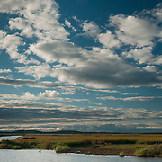Reflections of sky and the settng sun, Plum Island, Newbury, MA, first day of autumn.