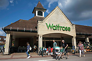 Shoppers leave a branch of Waitrose on 14th July 2021 in Wokingham, United Kingdom. John Lewis and Waitrose have announced plans to cut 1,000 jobs as part of a shake-up of store management to follow the closure of eight John Lewis stores earlier this year.