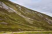 Car drives through the Glen Clunie hills, Scotland