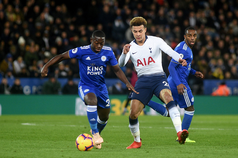 Tottenham Hotspur's Dele Alli battles with Leicester City's Nampalys Mendy<br /> <br /> Photographer Hannah Fountain/CameraSport<br /> <br /> The Premier League - Leicester City v Tottenham Hotspur - Saturday 8th December 2018 - King Power Stadium - Leicester<br /> <br /> World Copyright © 2018 CameraSport. All rights reserved. 43 Linden Ave. Countesthorpe. Leicester. England. LE8 5PG - Tel: +44 (0) 116 277 4147 - admin@camerasport.com - www.camerasport.com