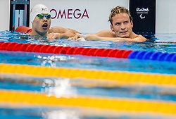 Guanglong Yang of China and Charles Rozoy of France after competed in the Swimming Men's 100m Individual Medley - SM8 Final during Day 10 of the Rio 2016 Summer Paralympics Games on September 17, 2016 in Olympic Aquatic Stadium, Rio de Janeiro, Brazil. Photo by Vid Ponikvar / Sportida