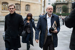© Licensed to London News Pictures. 17/01/2016. London, UK. Labour party leader JEREMY CORBYN (right)  arrives at BBC Broadcasting House with his adviser SEUMAS MILNE (left) and wife LAURA ALVAREZ (centre rear) to appear on The Andrew Marr Show on BBC One. Photo credit: Ben Cawthra/LNP