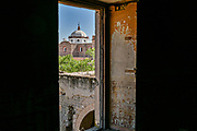 The Iglesia de San Diego De Alcalá as seen from a window in the Hacienda de Jaral de Berrio in Jaral de Berrios, Guanajuato, Mexico. The abandoned Jaral de Berrio hacienda was once the largest in Mexico and housed over 6,000 people on the property.