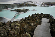 Blue Lagoon hot springs spa complex near Reykjavik, Iceland. The hot water is the byproduct of Svartsengi power plant, a geothermal electrical generating plant. Pumping 470 F (243 C) water from up to 1-1/4 miles beneath the earth, the plant generates electricity - and a somewhat cooler runoff that is rich in the kind of silicates and salts loved by devotees of mineral baths. Bathing is permitted only in the 2.5-acre (1 ha.) patch of the lake in which the water temperature is tolerable.