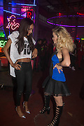 JOURDAN DUNN; RITA ORA, Club DKNY in celebration of DKNYARTWORKS hosted by Cara Delevingne  at The Fire Station, Lambeth High St. London. 12 June 2013
