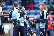 Luke O'Nien of Wycombe Wanderers (c) celebrates scoring his sides 1st goal with Garry Thompson of Wycombe Wanderers and Jason McCarthy of Wycombe Wanderers to make it 1-0. Skybet football league two match, Wycombe Wanderers  v Stevenage Town at Adams Park  in High Wycombe, Buckinghamshire on Saturday 12th March 2016.<br /> pic by John Patrick Fletcher, Andrew Orchard sports photography.