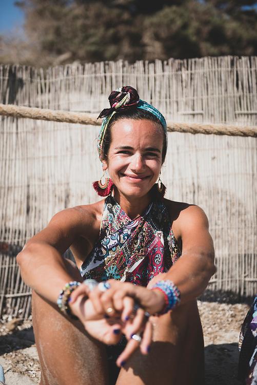 Ibiza, Spain - August 2, 2018: Lucrecia, from Argentina, at Salinas Beach in Ibiza, Spain