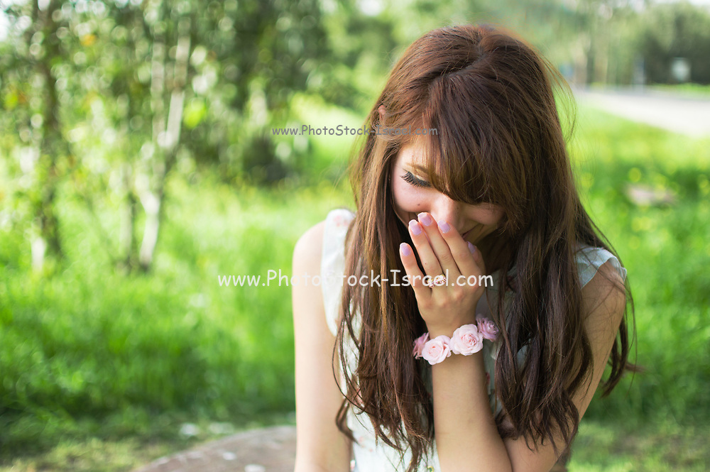 Portrait of a smiling and laughing young middle eastern woman in a park