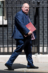 © Licensed to London News Pictures. 18/07/2014. London, UK. Eric Pickles leaves 10 Downing Street in London on 18 July 2014. Photo credit : Vickie Flores/LNP