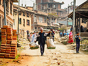 01 MARCH 2017 - KHOKANA, NEPAL:  A street scene in Khokana. Recovery seems to have barely begun nearly two years after the earthquake of 25 April 2015 that devastated Nepal. In some villages in the Kathmandu valley workers are working by hand to remove ruble and dig out destroyed buildings. About 9,000 people were killed and another 22,000 injured by the earthquake. The epicenter of the earthquake was east of the Gorka district.     PHOTO BY JACK KURTZ