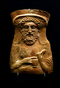 Terracotta proteome or bust of the god Dionysus Greek 380-360 BC. The god holds an egg and a wine jug.