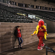 A young fan watches the ball game as Mittsy the mascot walks past during the Rochester Red Wings V The Scranton/Wilkes-Barre RailRiders, Minor League ball game at Frontier Field, Rochester, New York State. USA. 16th April 2013. Photo Tim Clayton