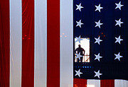 A man is seen through U.S. flag as he looks up into the dome at the Old Courthouse in Saint Louis.<br /> Photo by Jim Young