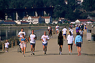 People running and walking on path at Crissy Field in the Presidio, San Francisco, California