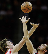 Nov 21, 2012; Houston, TX, USA; Houston Rockets center Omer Asik (3) and Chicago Bulls center Joakim Noah (13) reach for a jump ball during the first quarter at the Toyota Center. Mandatory Credit: Thomas Campbell-US PRESSWIRE