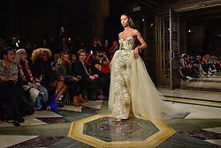 © Licensed to London News Pictures. 17/02/2018. LONDON, UK. A model presents a look by Vietnamese designer Mimi Tran at Fashion Scout AW18, part of London Fashion Week, taking place at Freemasons Hall in Covent Garden.   Photo credit: Stephen Chung/LNP