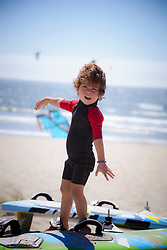 Portrait of a small child playing on the beach, Viana do Castelo, Norte Region, Portugal
