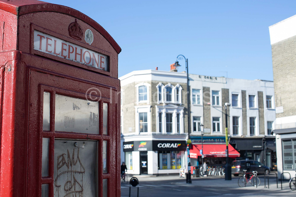 A red telephone box along Golbourne Road on the 26th March 2018 in West London, United Kingdom.