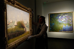 © Licensed to London News Pictures. 20/02/2018. London, UK. A painting titled Exterior de la Gare Saint-Lazare, effect de soleil by artist Claude Monet (R) is on show as part of the collection of Peggy and David Rockefeller at the Christies art sale. Photo credit: Ray Tang/LNP