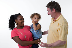 Man pulling a funny face to try and cheer up a young child,