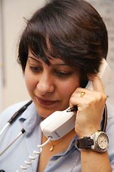 Portrait of Haematology Specialist Registrar on the telephone,