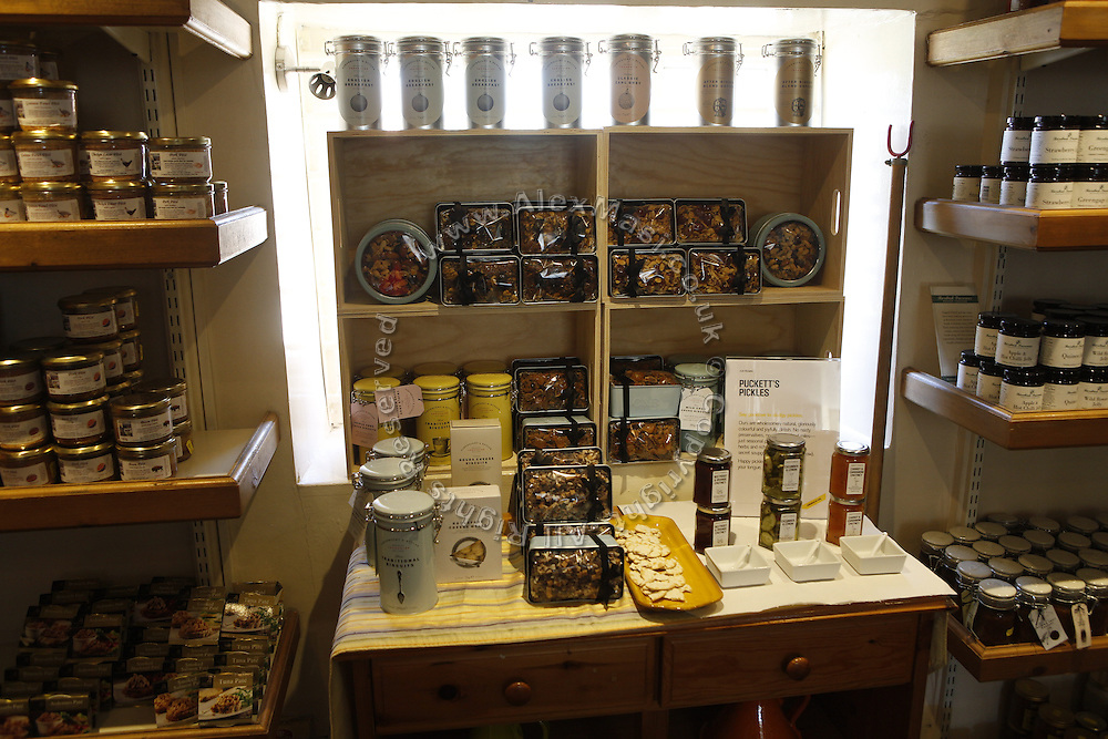 Traditional culinary items are on sale inside a shop on Helmsley's town square, Yorkshire, England, United Kingdom.