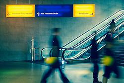 Passengers walking in interior of Potsdamer Platz railway station in Berlin Germany