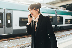 February 24, 2017 - Businesswoman using mobile phone in train station, Milan, Italy (Credit Image: © Eugenio Marongiu/Image Source via ZUMA Press)