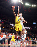 CHARLOTTESVILLE, VA- NOVEMBER 29: Trey Burke #3 of the Michigan Wolverines shoots in front of v12/ during the game on November 29, 2011 at the John Paul Jones Arena in Charlottesville, Virginia. Virginia defeated Michigan 70-58. (Photo by Andrew Shurtleff/Getty Images) *** Local Caption *** Joe Harris;Trey Burke