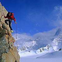 ANTARCTICA, Alex Lowe (MR) climbs Mount Bearskin (2850m) in northern Ellsworth Mountains.  Mount Tyree background.