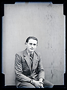 studio portrait of a young adult man in suit circa 1930s
