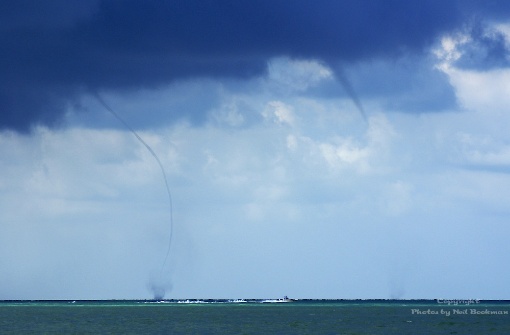 A water spout occured off the coast of Sanibel, FL. While I was shooting the one, another one appeared!
