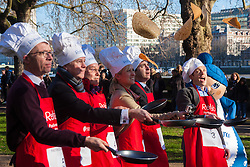 London, February 17th 2015. Members of Parliament put their dignity aside for a bit of fun as they compete in the annual Parliamentary Pancake Race in Victoria Tower Gardens adjacent to the House of Lords.  PICTURED: The media team, left to right, the Guardian's Patrick Wintour, Robbie Gibb of Sunday Politics, the Sunday People's Political Editor Nigel Nelson, Nigel Nelson, Sky News Political Correspondent Sophie Ridge, and BBC Political Correspondent Ben Wright.